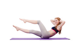 Young female doing exercises Stock Photos