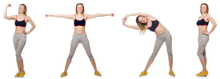 The young female doing exercises on white Stock Images
