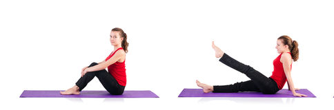 The young female doing exercises on white Royalty Free Stock Photos