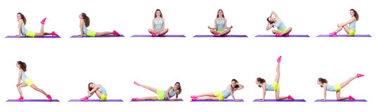The young female doing exercises on white Stock Photography