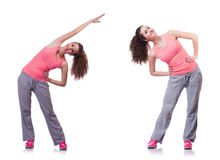 The young female doing exercises on white Royalty Free Stock Image
