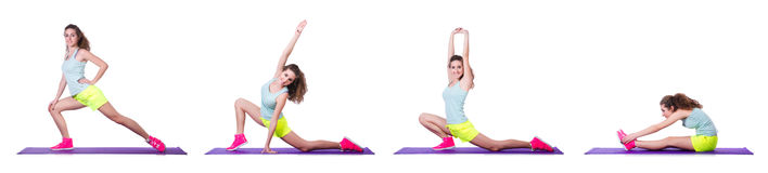 The young female doing exercises on white Royalty Free Stock Images