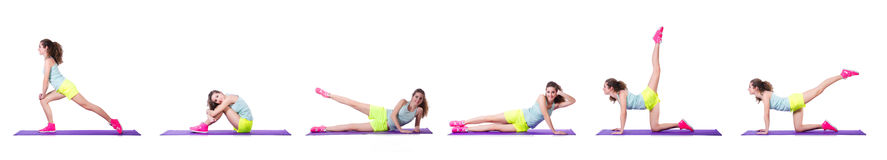 The young female doing exercises on white Stock Photos