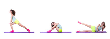 The young female doing exercises on white Royalty Free Stock Photography