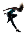 Young female doing gymnastic jump studio. Side view of a young beautiful girl doing gymnastic jump in studio on white background Royalty Free Stock Images