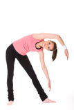 Young female doing some exercises on white floor Royalty Free Stock Photo