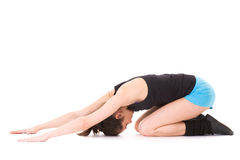 Young female doing some exercises on white floor Royalty Free Stock Image