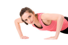 Young female doing some push-up on white floor Royalty Free Stock Photography