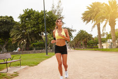Young female doing sport outside in summertime Royalty Free Stock Photos
