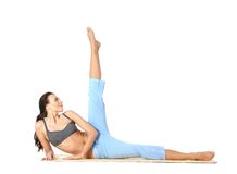 A young female is doing stretching exercise Stock Image