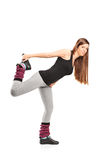 Young female doing stretching exercise Royalty Free Stock Photo