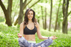 Young Female doing yoga meditation outdoor Stock Photography