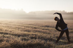 Young female doing yoga in the morning Stock Photography