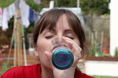 A young female drinking a glass of water Royalty Free Stock Images