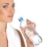 A young female is drinking refreshing water Stock Images