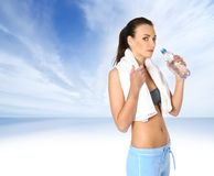 A young female is drinking refreshing water Royalty Free Stock Photos