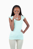 Young female drinking water Stock Photography