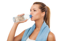 Young female drinking water after exercise Stock Photos