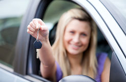Young female driver holding a key Stock Photo