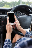 Young female driver using touch screen smartphon stock images