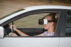 Woman learning to drive with virtual reality glasses royalty free stock photos