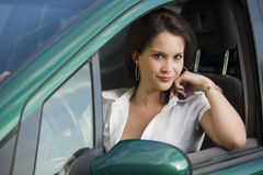 Young female driving car Stock Photos
