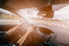 Young female driving a car Royalty Free Stock Images