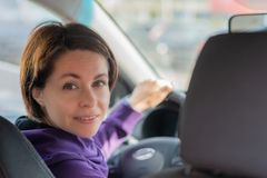 Young Female Driving Car on Highway in Country During summer. Backseat View stock image