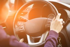 Young Female Driving Car on Highway in Country During summer. Backseat View royalty free stock images