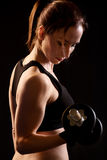 Young female with dumbbells Stock Images