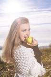 Young Female Eating Green Apple Stock Photography