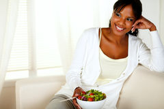 Young female eating healthy salad lunch stock image