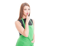Young female employee doing a quiet gesture Stock Images