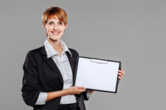 Young female employee holding a clipboard Stock Photo