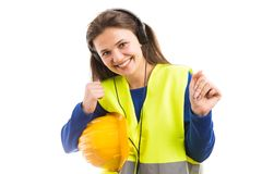 Young female engineer listening to music and dancing stock photography