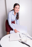 Young female engineer is smiling into camera Royalty Free Stock Image