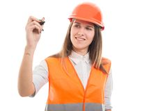 Young female engineer writing on blank screen Stock Photos