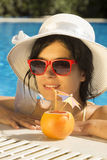 Young female enjoying her vacation Royalty Free Stock Image