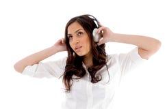 Young female enjoying music. With white background Royalty Free Stock Photography