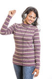 Young female enjoying the music. Royalty Free Stock Photos
