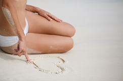 Young female enjoying sunny day on tropical beach Stock Photography