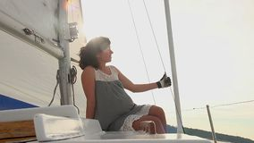 Young female enjoying yacht trip, summer vacation, traveling. Stock footage stock video