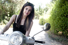 Young female enjoys a motorcycle ride Royalty Free Stock Image