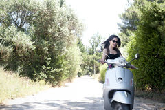 Young female enjoys a motorcycle ride Stock Image