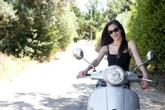 Young female enjoys a motorcycle ride Stock Photography
