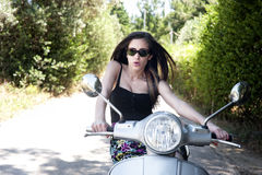 Young female enjoys a motorcycle ride Stock Images