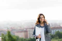 Young female entrepreneur on cellphone call Stock Images