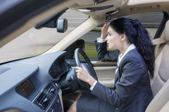 Young female entrepreneur driving car Stock Photography