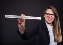 Young female entrepreneur showing measurement ruler Stock Photography