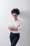 Young female entrepreneur. Standing at wall royalty free stock images